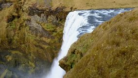 Skogafoss powerfull waterfall in iceland Popular tourist attraction shoot in 1080. Top view Skogafoss powerfull waterfall in iceland Popular tourist attraction stock video footage