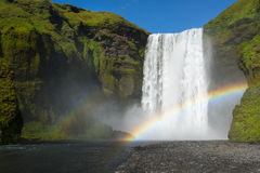 Skogafoss waterfall with double rainbow at perfect sunny day, Iceland Stock Photo