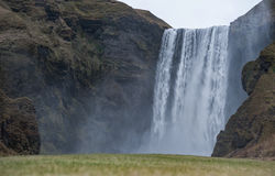 Skogafoss Waterfall In Iceland. Close Up with Water Spray and Rocks. Stock Photos