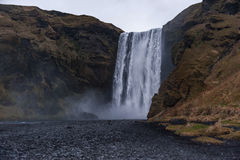 Skogafoss Waterfall In Iceland. Long Exposure Water Spray and Rocks. Stock Images