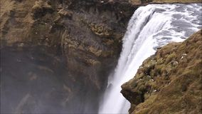 Skogafoss waterfall in Iceland. One of many Iceland waterfalls with rainbow - skogafoss stock footage