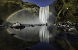 The Skogafoss waterfall Iceland Picturesque huge rainbow appears in the water mist. Royalty Free Stock Photo