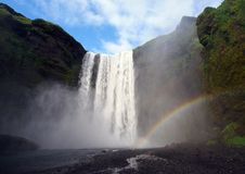 Skogafoss waterfall with Rainbow royalty free stock image