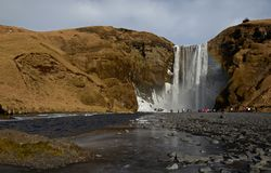 Skogafoss waterfall on the Skougau river, in the south of Iceland, in the Sydurland region. Located in the cliffs of the former coastline near the village of stock images