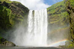 Skogarfoss fall on the Iceland with a rainbow Stock Photography