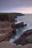 Skokholm Island North coast to lighthouse. A view of Skokholm Islands noirth coast as the sun sets Stock Photography