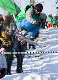 skokowy snowboarder Fotografia Royalty Free
