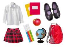 Skola den kvinnliga likformign & tillförsel som isoleras på vit royaltyfri bild