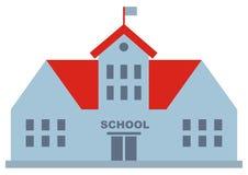 Skolabyggnad med det röda taket och flaggan Fotografering för Bildbyråer