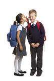 Skolaflicka som viskar i pojkeöra Fotografering för Bildbyråer