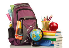 Skolaryggsäck med skolatillförsel Fotografering för Bildbyråer