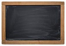Skolasvart tavla som isoleras på vit Arkivfoton