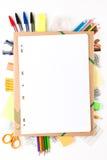 Skolautrustning med anteckningsboken Fotografering för Bildbyråer