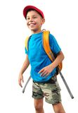 Skolbarn med ryggsäcken och ett lock arkivfoto