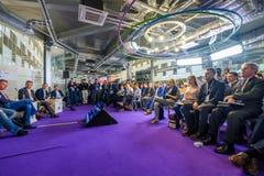 People attend Open Innovations 2017 forum. Skolokovo, Russia - October 16, 2017: People attend Open Innovations 2017 forum in new building Skolkovo Technopark Royalty Free Stock Photos