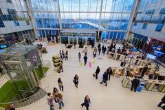 People attend Open Innovations 2017 forum. Skolokovo, Russia - October 16, 2017: People attend Open Innovations 2017 forum in new building Skolkovo Technopark Stock Images