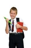 Skolpojke med boken och blyertspennan Royaltyfri Foto