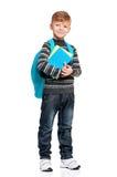 Skolpojke med ryggsäcken och böcker Arkivfoto