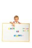 Skolpojke som pekar till meddelandet Fotografering för Bildbyråer
