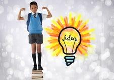 Skolpojkeanseende på boktorn med färgrika idédiagram för ljus kula Royaltyfri Fotografi