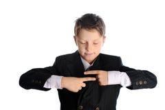 Skolpojken är läs- förmögenhet arkivbild