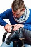 Skomakare - skoreparation Fotografering för Bildbyråer