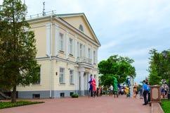 Skomorokhs on stilts are near puppet theater during festival of Slavic Bazaar, Vitebsk, Belarus Royalty Free Stock Photography