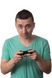 Skoncentrowany mężczyzna Bawić się Wideo gry Na Białym tle obrazy royalty free