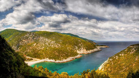 Skopelos Island Greece. Glisteri beach - panorama of the picturesque bay and beach on the Skopelos island, Greece. The view from the top of the cliffs above the stock photo