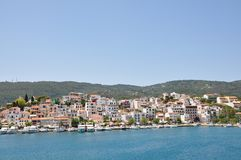 Skopelos island seaside coastline town with buildings, typical greek view stock image