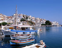 Skopelos Port. Skopelos town. A greek island. Looking over the harbour towards the church stock image