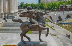 SKOPJE, MACEDONIA - June, 2017: Bronze sculpture of a furious man on a horse in Skopje royalty free stock photography
