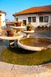 Skopje, Macedonia - november 2011. Cozy courtyard with a fountain near the cafe stock photography