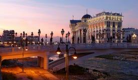 Skopje night scene at dawn. Macedonian museum of Archeology and bridge called Eye Stock Photography