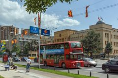 A red double-decker bus passing through the streets of city of Skopje, Republic of Stock Photo