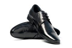 skor för svart man s Fotografering för Bildbyråer
