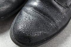 skor för svart man s Arkivfoton