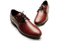 skor för män s Arkivfoto