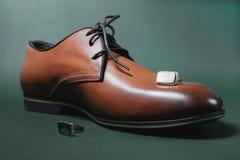 Skor och manschett arkivfoton
