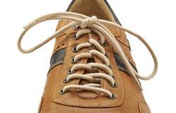 Skosnöre i övre och brun sko för slut Arkivbild