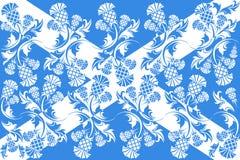 Skotsk flagga med prydnader av blommatisteln Arkivbilder