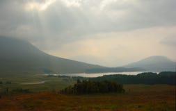 Skotska högländernasolstrålar Arkivbilder