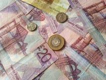 Skotska pundanmärkningar och mynt Fotografering för Bildbyråer