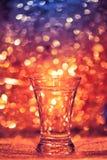 Skottexponeringsglas av vodka Royaltyfria Bilder