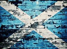 Skottland flagga som målas på den gamla tegelstenväggen Royaltyfri Bild