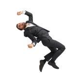 Skrämd affärsman som ner faller arkivfoton