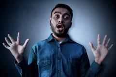 Skrämd asiatisk man och chockuttryck Fotografering för Bildbyråer