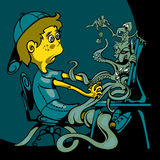 Skrämd sitter pojken på datoren Bildskärmkrypning med monster och lektecken Arkivbilder