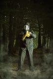 Skrämma galningen med chainsawen Fotografering för Bildbyråer