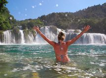 Skradinski buk, Croatia. The girl near the waterfall Skradinski buk, Croatia Royalty Free Stock Photography